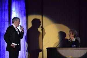 John singing to Judy